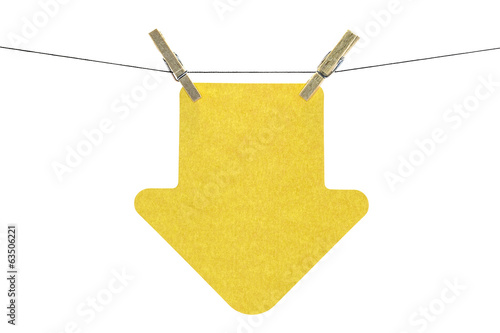 Flat yellow arrow sticky note hanged, on white background