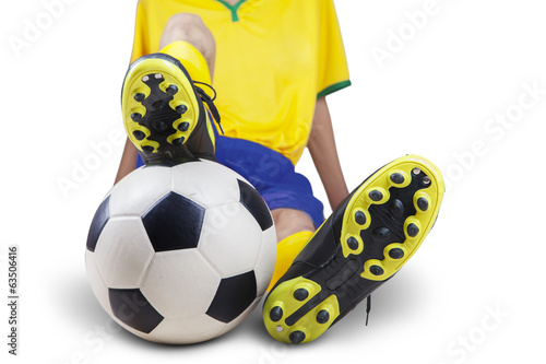 Football player sitting with ball isolated 1