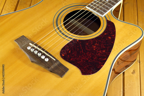 Acoustic guitar top with six strings closeup