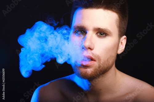 portrait of young man smoking cigarette