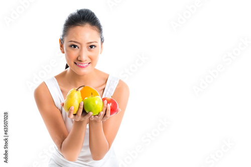 Asian woman offering healthy fruits