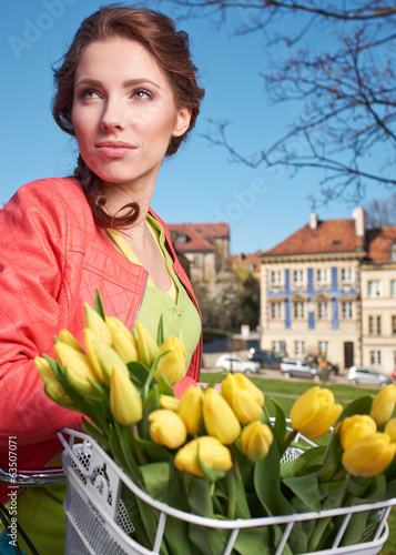 Spring woman with flowers in Paris street