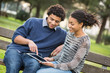 Mixed-Race Couple Using Digital Tablet