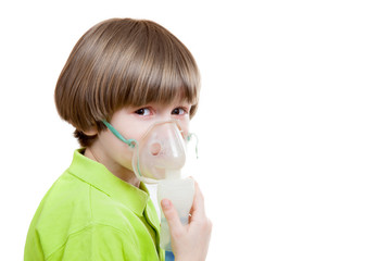 The boy with inhaler against white background