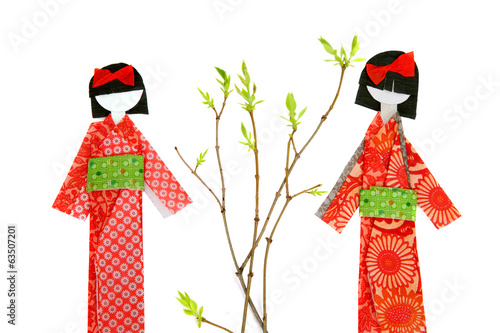 Two japanese paper doll isolated on white background