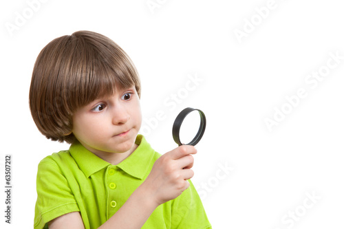Little boy with magnifier against white background