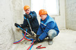 engineer repairmen installing heating system