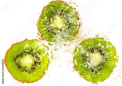 juicy kiwi fruit in water on a white background. macro