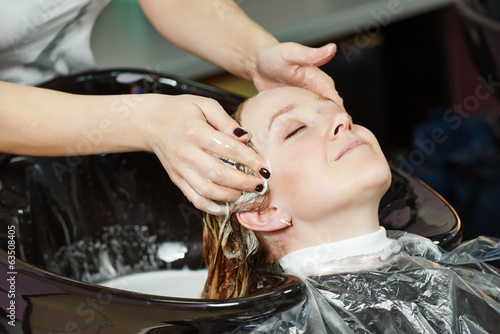 Highlight. woman hair washing in salon