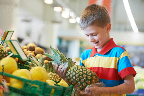 Child shopping at supermarket