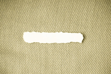 scrap paper blank copy space on beige fabric textile material