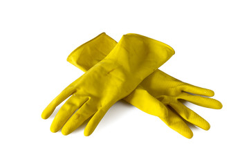 Yellow  old rubber gloves isolated on white