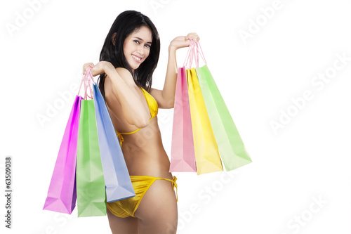 Sexy woman holding shopping bags isolated