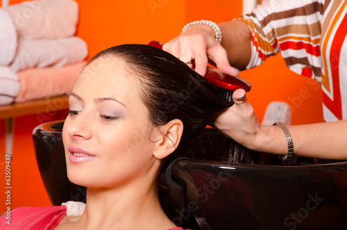 Girl washing hair in hairdressing salon