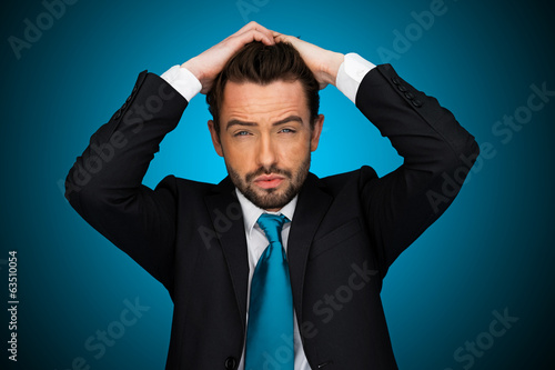 flustraded businessman on blue background ,