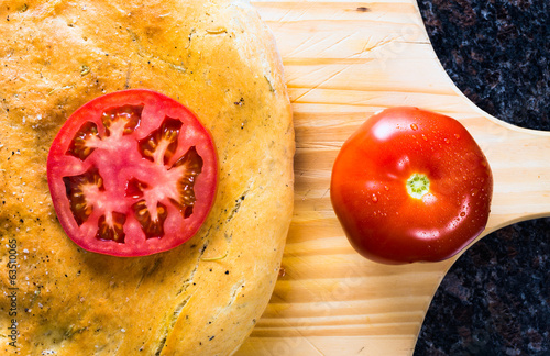Loaf of Focaccia bread with tomatoes.