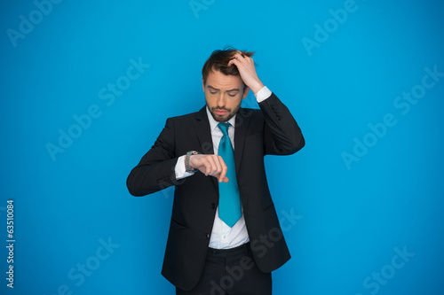 businessman in rush looking at his watch , running late