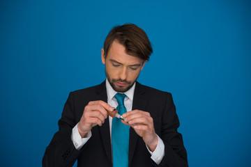 businessman topping up his e-cigarette with e-liquid