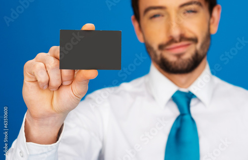 Businessman holding blank businesscard