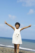 little girl on beach hand raised freedom concept photo