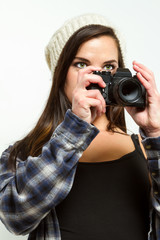 Female photographer frames a picture