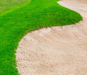Sand and grass at golf course