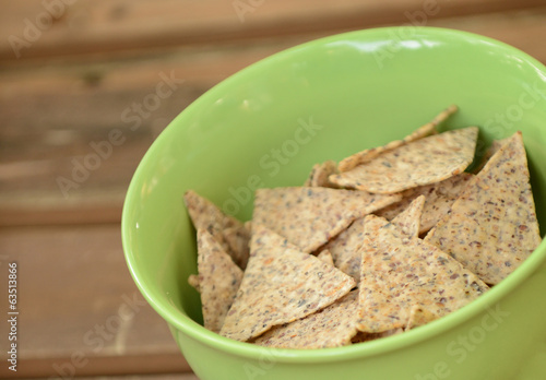 tortilla chips in a green bowl