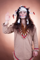 Native american men greeting on brown background
