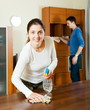 Girl with husband cleaning furniture