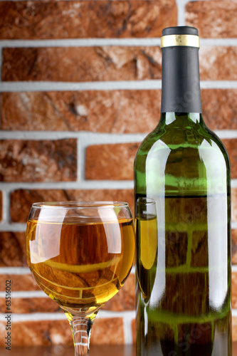 Wineglass on brick wall