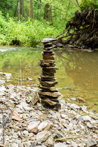 Stones pyramid near small river