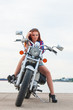 Beautiful, sexy, young woman on a motorcycle