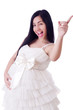 Pregnant woman in wedding dress on white
