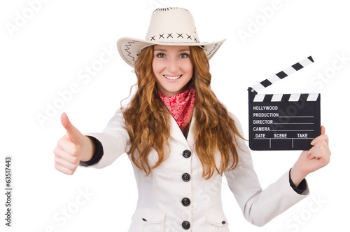 Young   thumbing  cowgirl  with movie board isolated on white