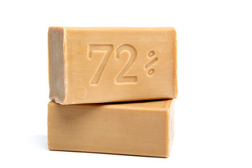 Two pieces of economic simple natural soap on white background.