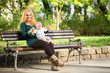 Mom with baby on a park bench