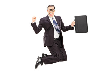 Excited businessman jumping with joy