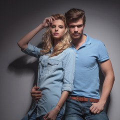 fashion young couple posing for the camera