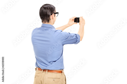 Man taking a picture with cell phone