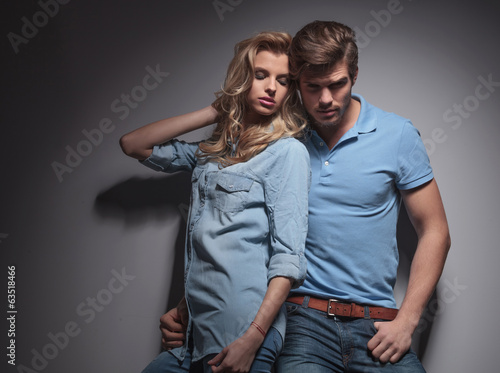 woman leaning against her boyfriend