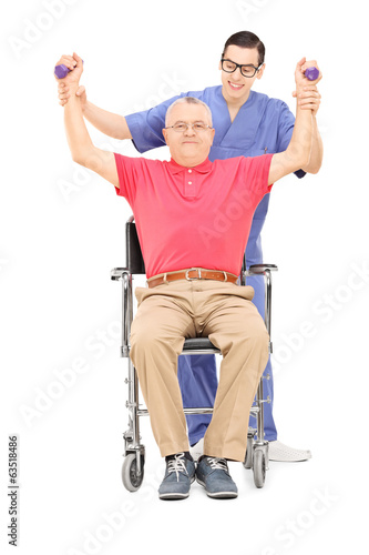 Mature man exercising with a physiotherapist
