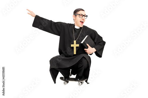 Silly priest riding a small skateboard