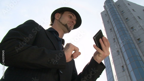 Businessman gesturing on touchscreen smartphone