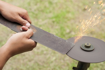 Lawn mower blade sharpening.