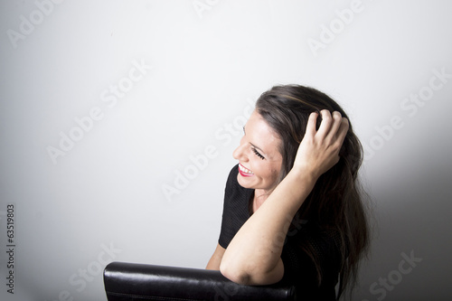 Beautiful attractive woman laughing in studio (portrait)