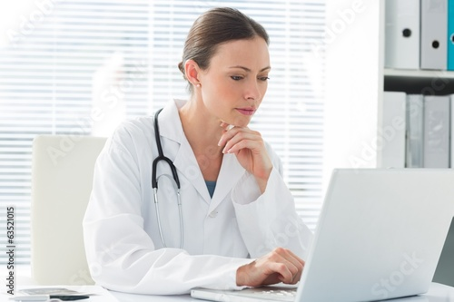Female doctor using laptop