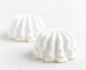 White marshmallow on wooden table