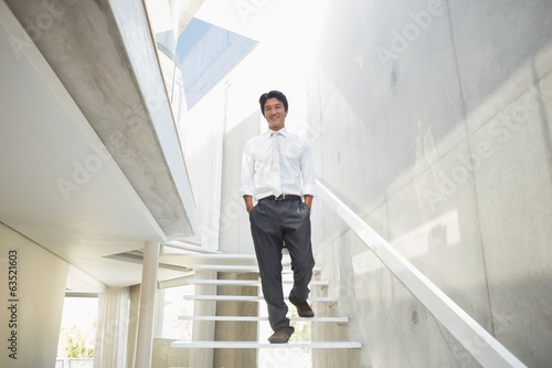 Man walking with hands in pockets