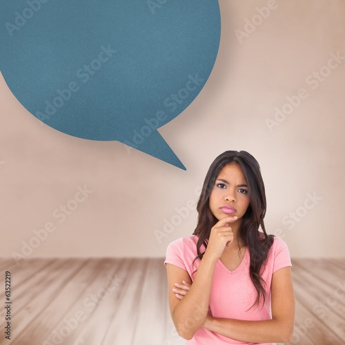 Composite image of pretty brunette thinking