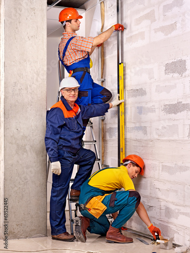 Men in builder uniform.